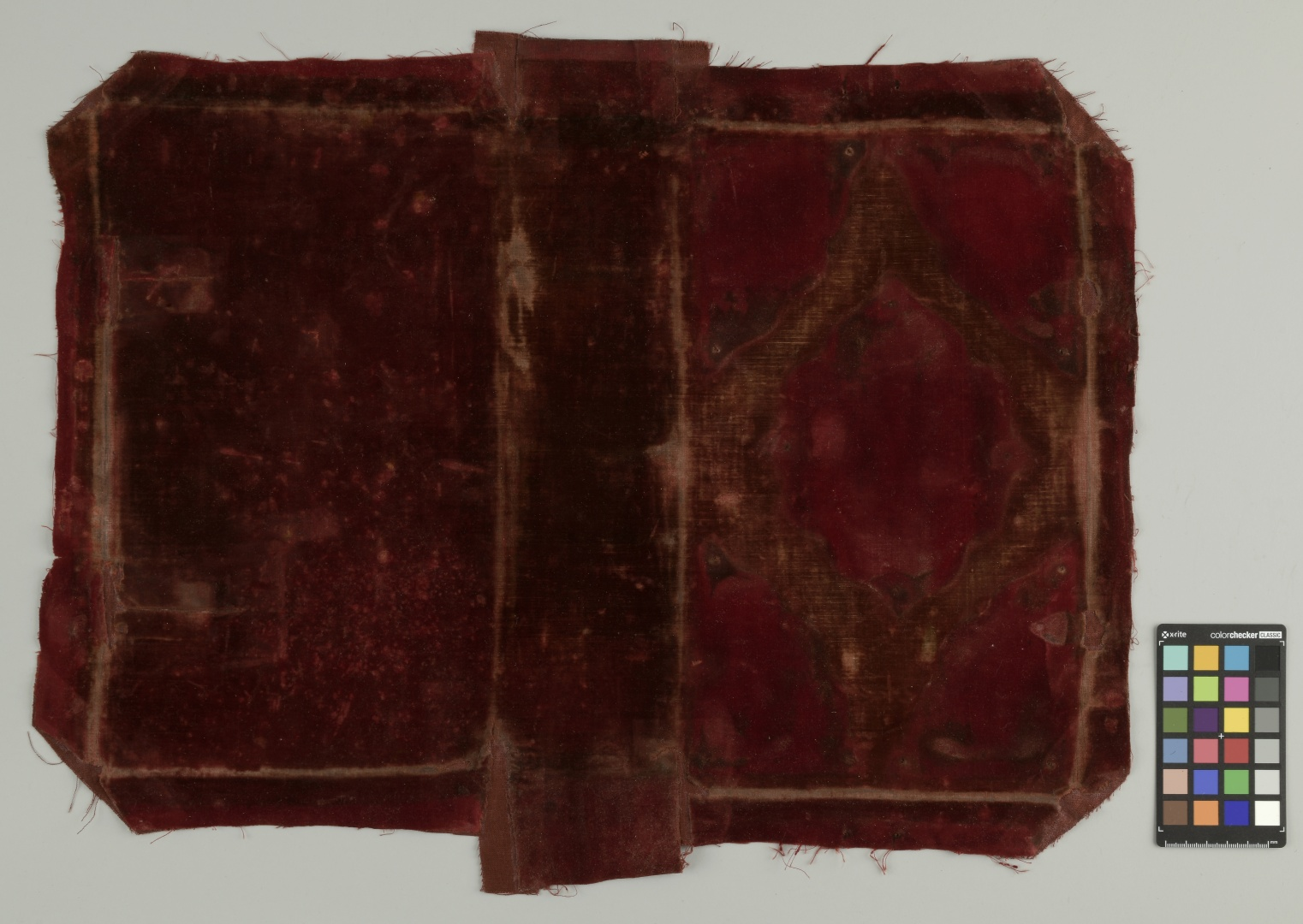 ill 28. It was decided to conserve the silk velvet fabric instead replacing it with new material. The fabric was locally cleaned of wax spots and washed on a suction table with low vacuum pressure. The tears and rips were backed with silk cloth.