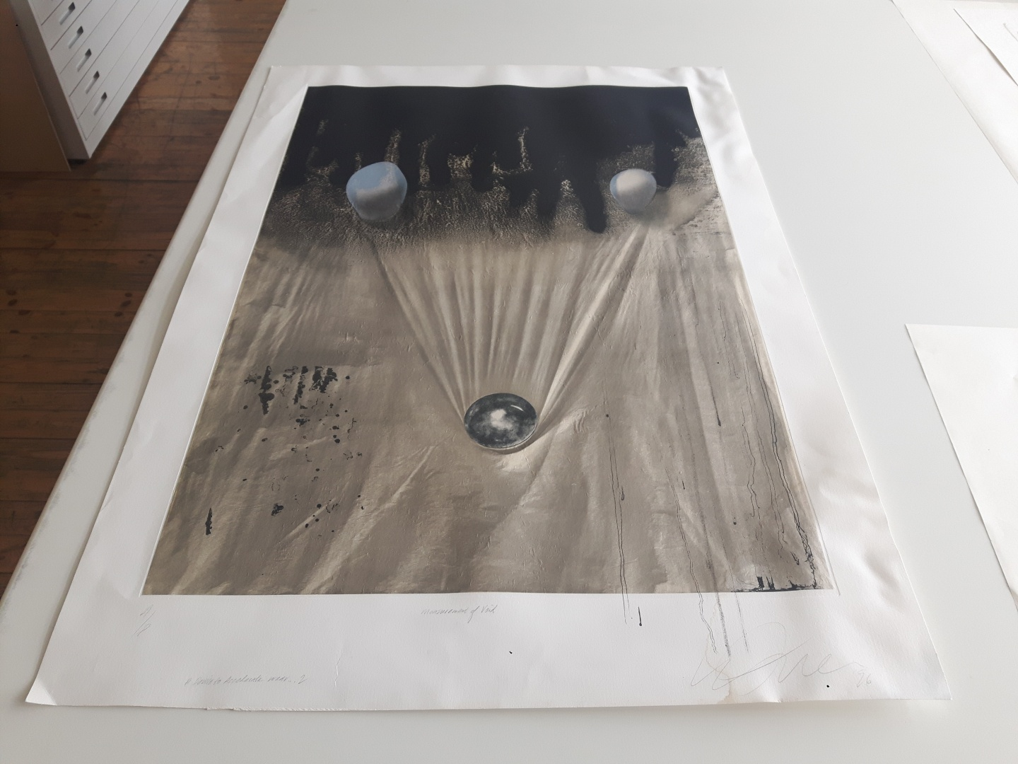 fig 14. Conservation of Walter Jule's print in mixed technique Measurement of Void – A Device to Accelerate Wear that had been damaged in a water-accident started in 2018. The work before conservation.