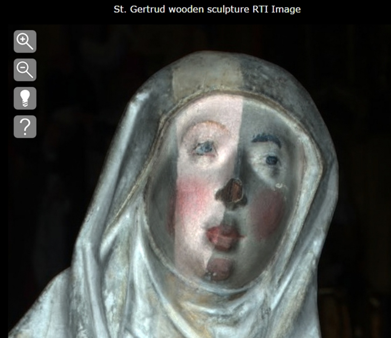 ill 8. Detail of the sculpture of St Gertrude in the high altar of St Nicholas' Church in Tallinn – the  RTI image is easily observed on the web as well. Surface cleaning is noticeable.  Niguliste Museum.
