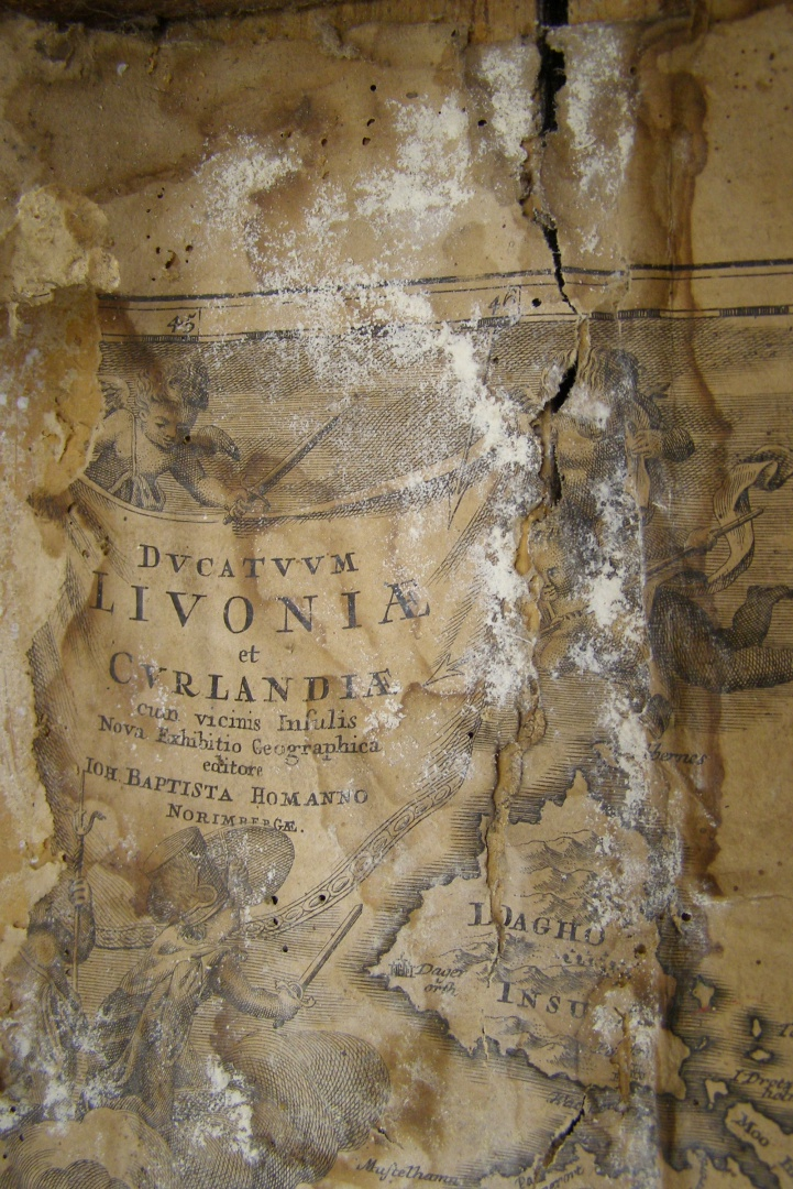 ill 15. The paper of the map was yellowed and fragile, there were splotches of mould and distinct water lines.