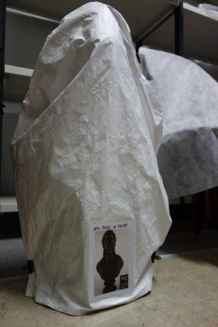 fig 19. Conservation completed. Enveloping cover was made of Tyvek for protection from loose-flying dust with a label describing the museum piece added to its front.