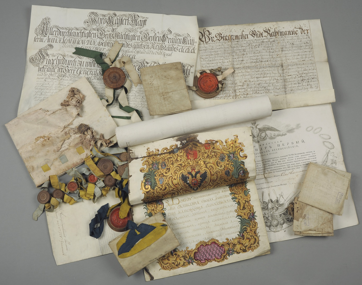 fig 1. Historical parchments that have preserved in the collections of the Estonian History Museum before their conservation.