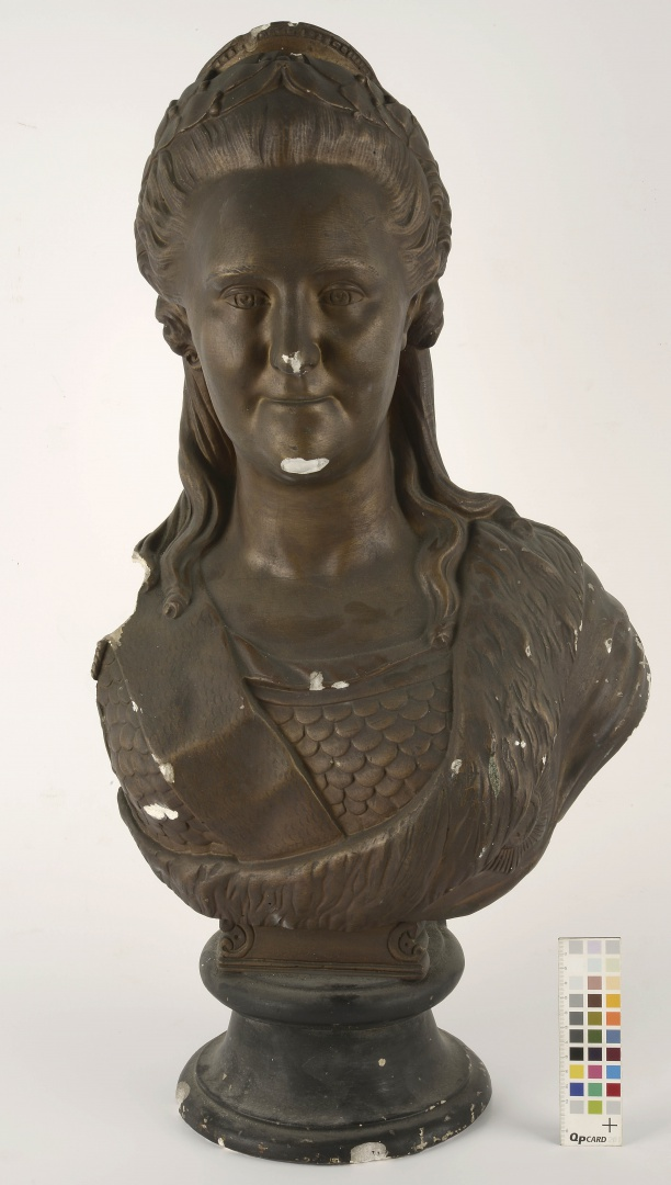 fig 1. Front view of the sculpture before conservation. The most obvious missing part is the left side (shoulder). Losses of material and paint layer are seen on the bust.