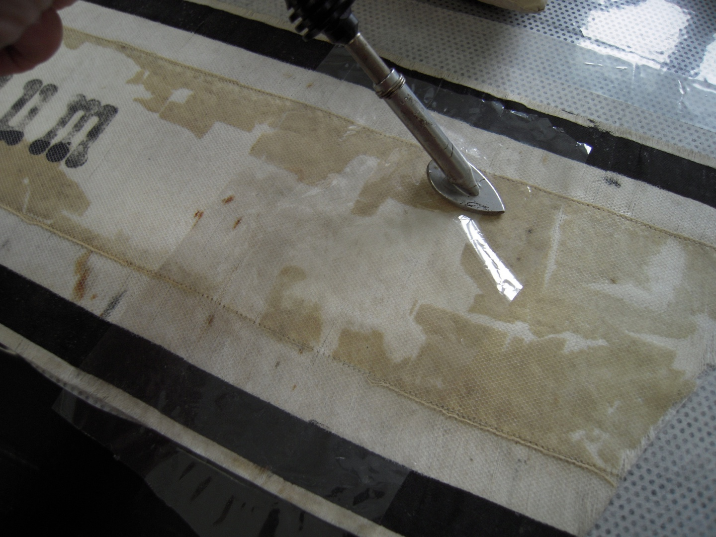 ill 24. Thermal processing with a heated spatula. The whole surface of the ribbon was covered with netting to warrant its free hanging when displayed.