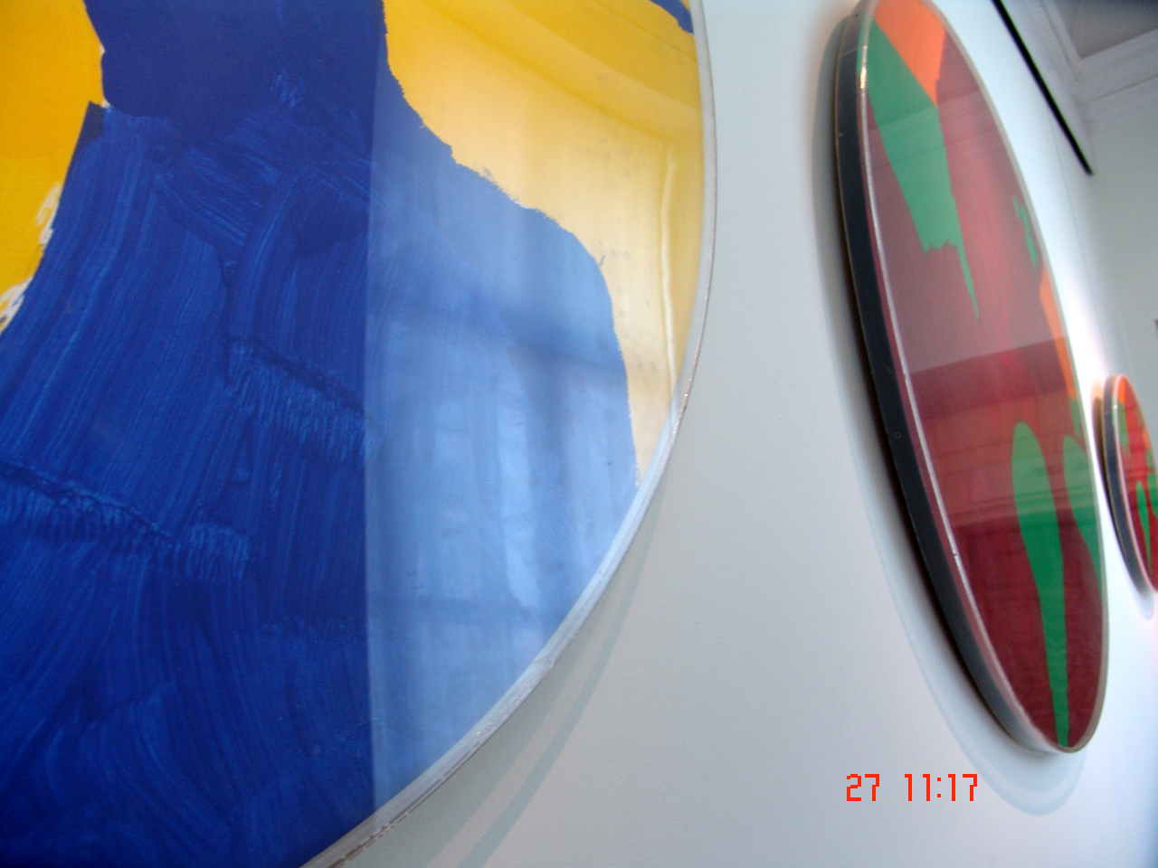 ill 6. Forming of the front side. The paintings have been covered with bent Plexiglas.