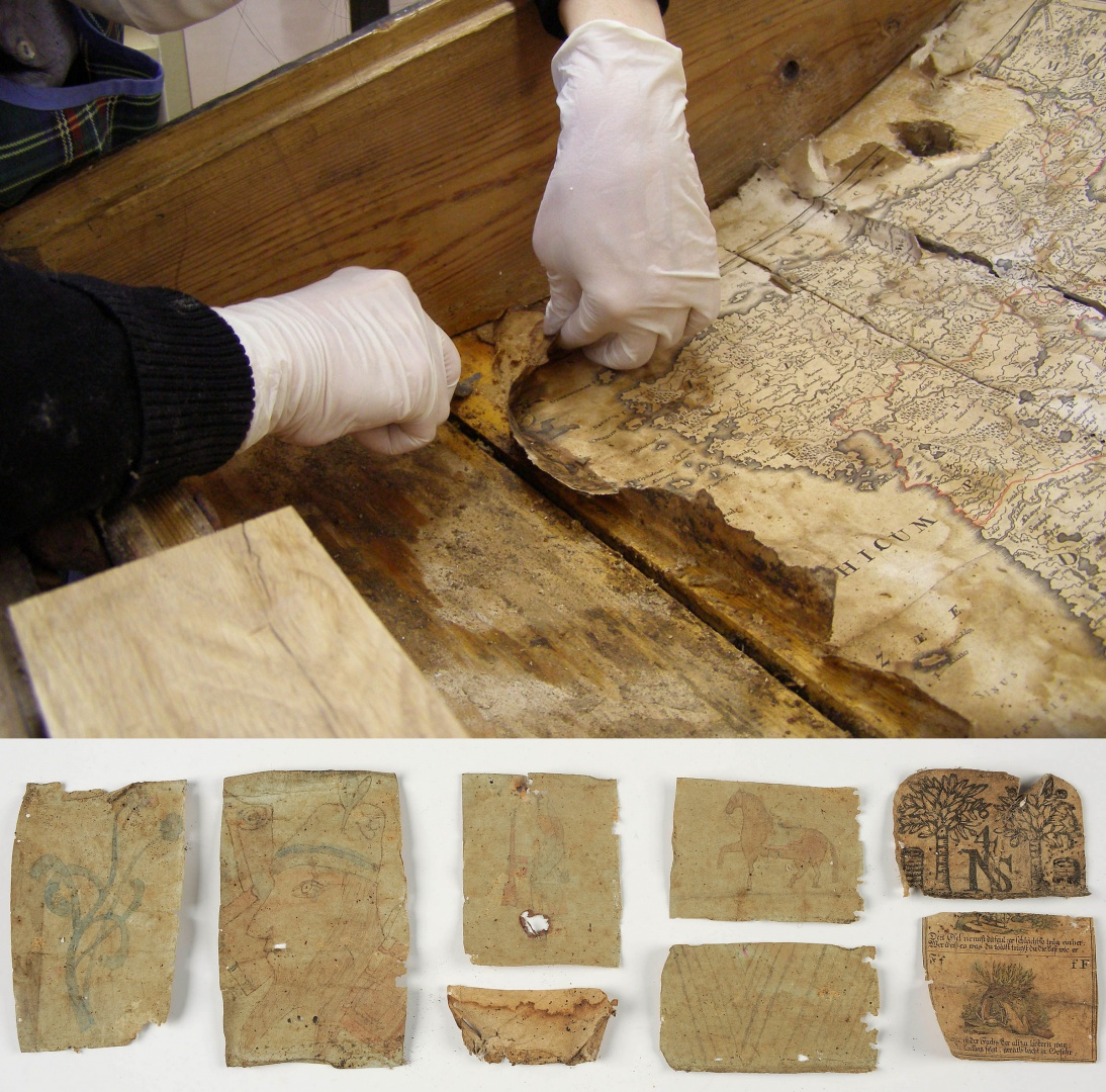 ill 7. Paper objects were removed from the lid of the chest dampening the contact surfaces with ethanol.