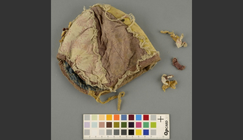 fig 12. Cap 2. EKM j 41197 KR 460/b. the right side before conservation – damages and some loose decorative details like lace and the strips of fabric.