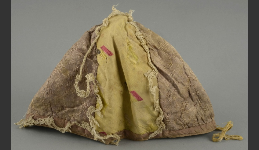 fig 14. Cap 2. The front part before conservation. The cap was deformed and its decorative lace had unravelled at places.