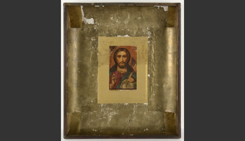 fig 15. Tears and holes in the base paper were filled with hand-tinted paper. The conserved paper was fixed around the bottom of the box and the icon. On the edges of the box concave surfaces appeared that helped to shape the metal cover properly.