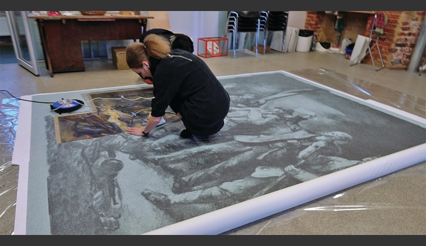 fig 25. Planting the preserved fragments of the paintings Blessing of the Flag and Going to the War of Independence on the photo-canvas and the reconstruction of the whole mural at the Estonian Academy of Art in March 2018. Photo: Villu Plink