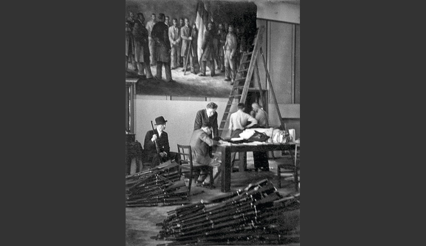 fig 2. Estonian Student Society was ordered to vacuate their building and give it up to the occupational forces of the Soviet Union in June 1940. The author of the mural, Aleksander Bergman helped to take the triptych down. The rifles visible in the photo belonged to the 3rd subdivision of the students' societies in the Tartu Defence League (Kaitseliit) and were stored in the EÜS building