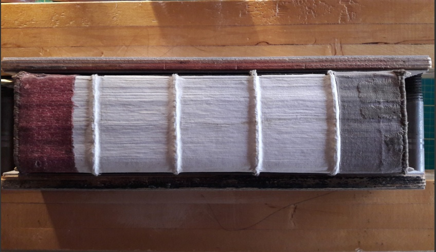 ill 33. The strengthened back of the block with Japanese paper and conserved headbands. © Tulvi Turo