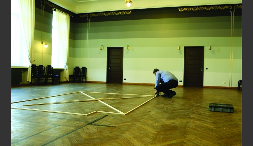 fig 7. Measuring the place in the EÜS hall where the mural had been (summer of 2015). Photo: the Estonian Student Society