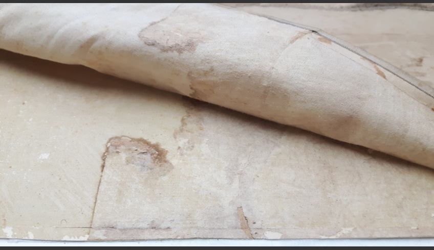 fig 3. The textile backing was evidently not original as the tears (5cm up and 15cm down) in the paper that penetrated two layers had been mended on the reverse side with robust rag-paper patches. The backing textile was whole, referring to some later-day repairs.