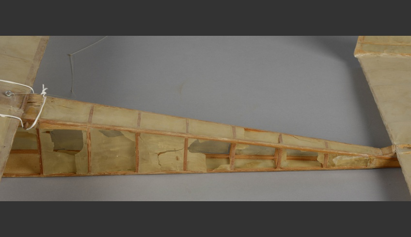 ill 3. Model plane 1. The silk on the wooden structure was torn and had holes in it.