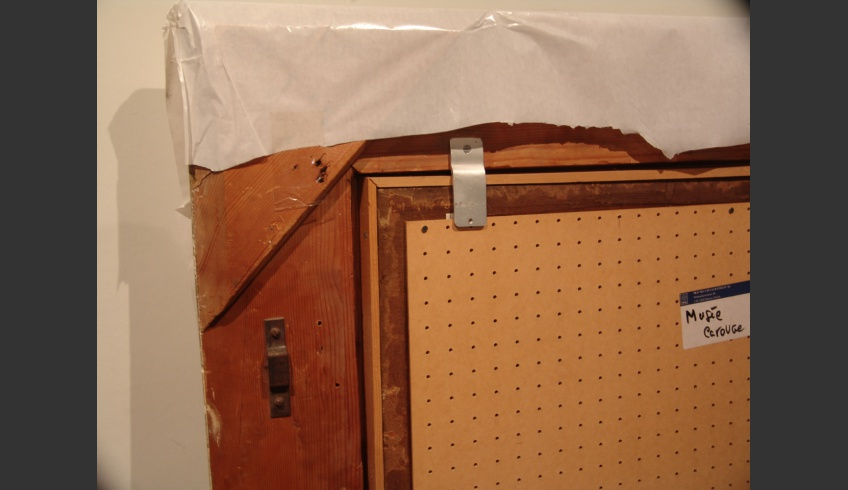 ill 5. Forming of the reverse side. The painting has been covered with perforated masonite (the so-called Finnish cardboard) panel.