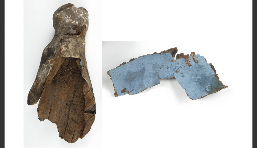 fig 6. The sarcophagus had suffered several repairs in the past. The hole on the scruff of the figure had been filled with blue cardboard and covered with a piece of the original linen fabric.