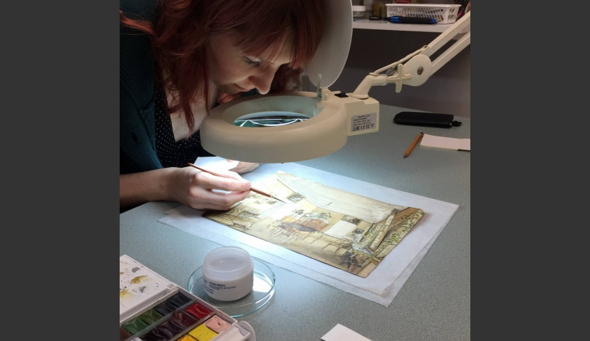 ill 31. Conservator Tea Shumanov retouching the losses in the watercolours. Photo – V. Vissel